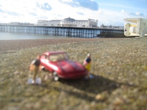 Little Peoplecb and Matchboc Toy Car with view of Brighton Pier